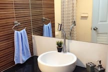 Nice bathroom with amenities, clean & soft towels, rain shower with warm water should you need to pamper your muscles after a long day...