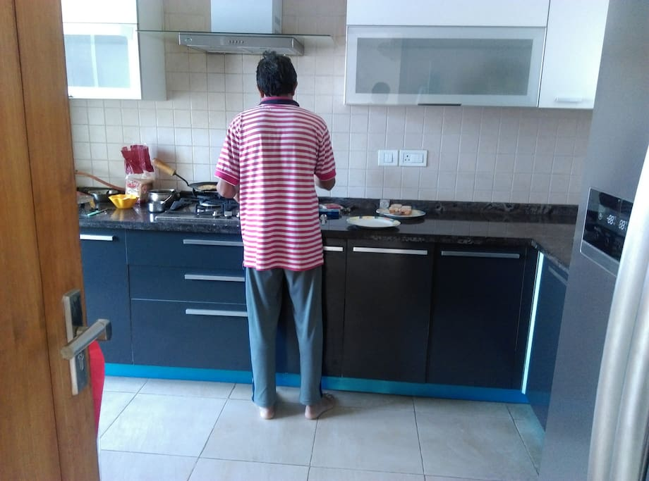 servant doing cooking in kitchen