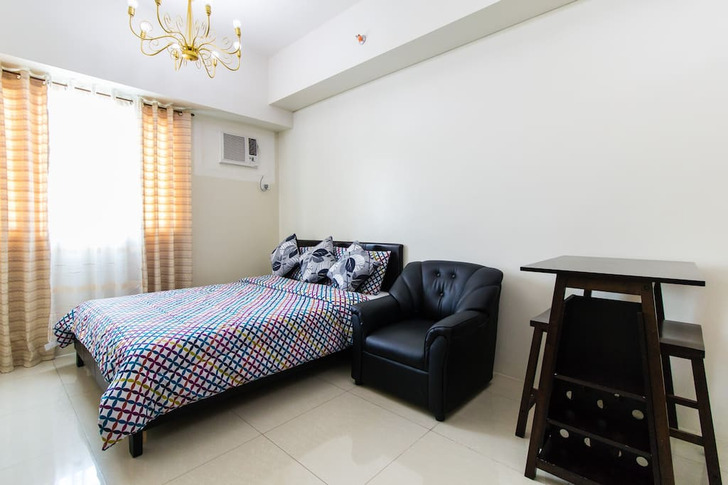 With queen size bed and beddings,1 seater leather sofa, 2 seater dining set and remote aircon. View is poolside.