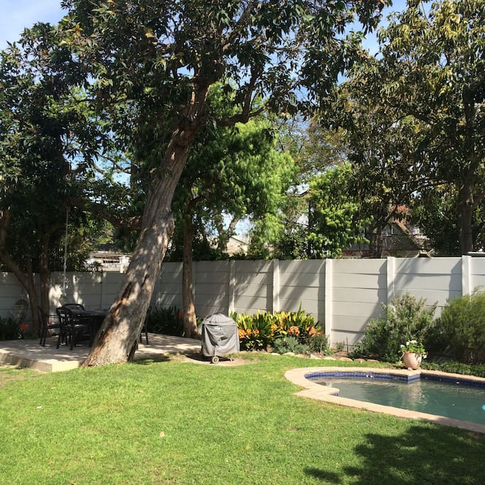Leafy garden with  pool and garden patio