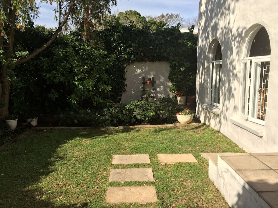 Front courtyard entrance garden with water feature
