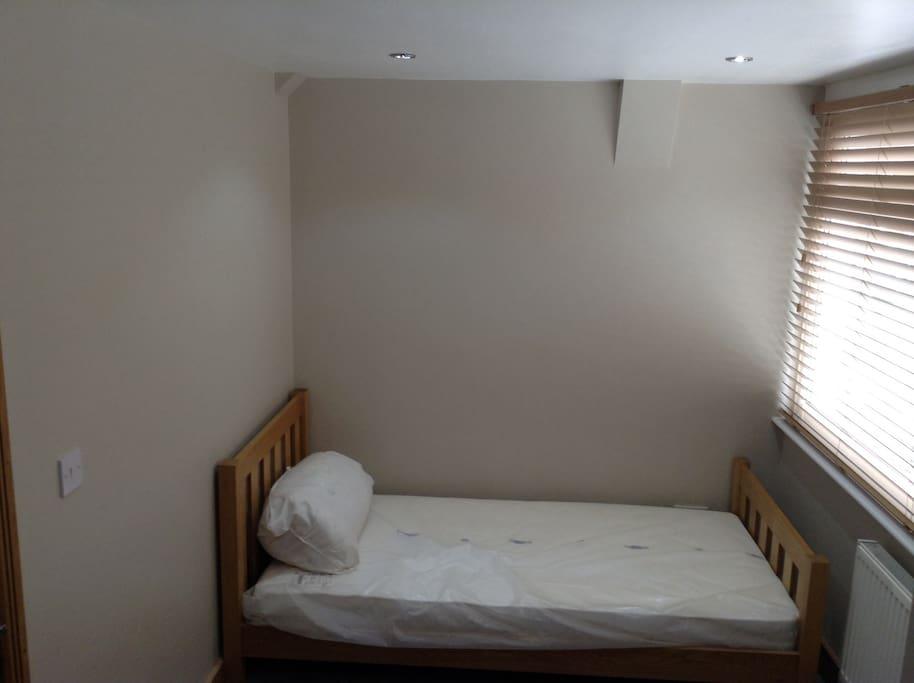Single room with wardrobe and cheats of draws