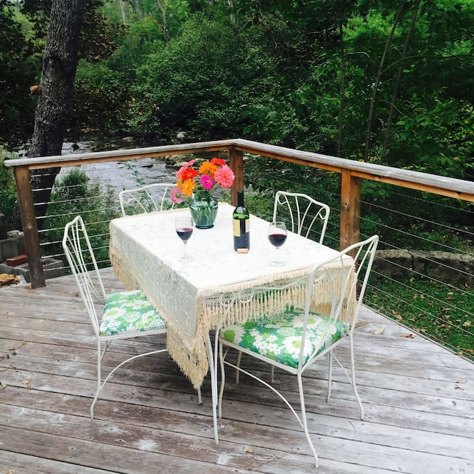 Enjoy a meal on the large deck overlooking Elk Creek.