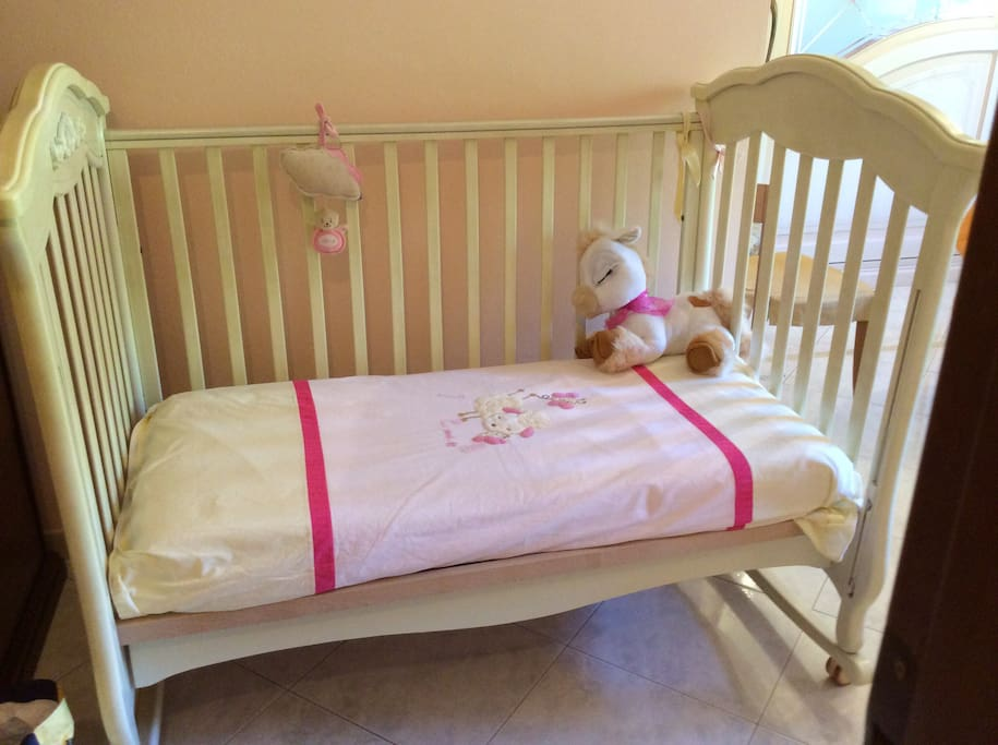 The lovely and absolutely new baby bed with bars