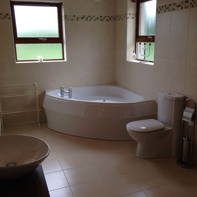 This is the en-suite bathroom with a jacuzzi bath.