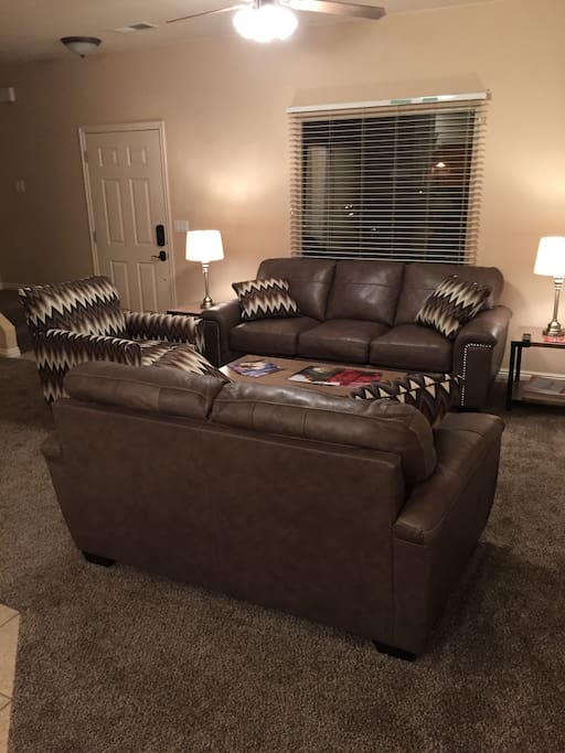 Living Room with Premium Leather Sleeper Sofa & Loveseat