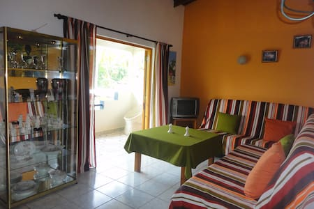 Apartment near beach with A/C, pool and garden