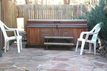 Hot tub with privacy fence enclosure