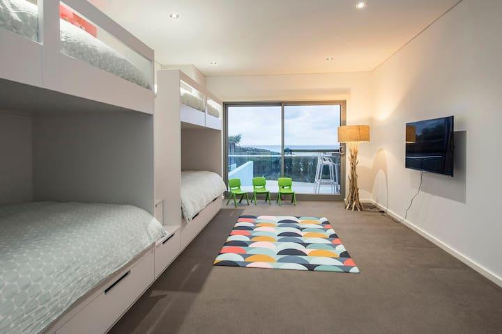 Bunk room with sliding door access to deck