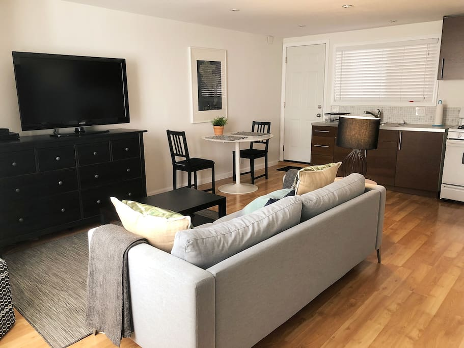The main living space has a comfy couch that you can stretch out on, a full kitchen and an eating area. That's the 46in flat screen TV with HBO and a Blu-Ray player, if you were wondering.