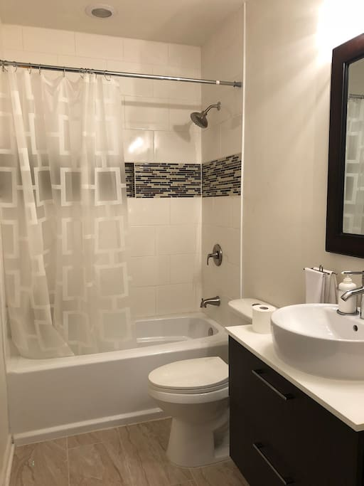 Bathroom with washer/dryer in closet, 1 tide pod included per week stay