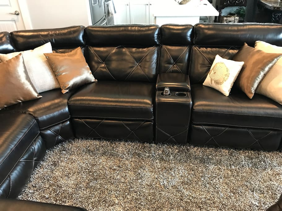 Kick back on the comfy leather furniture in the living room.
