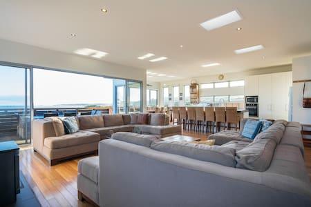 'ON THE BEACH' Huge Beachfront Home