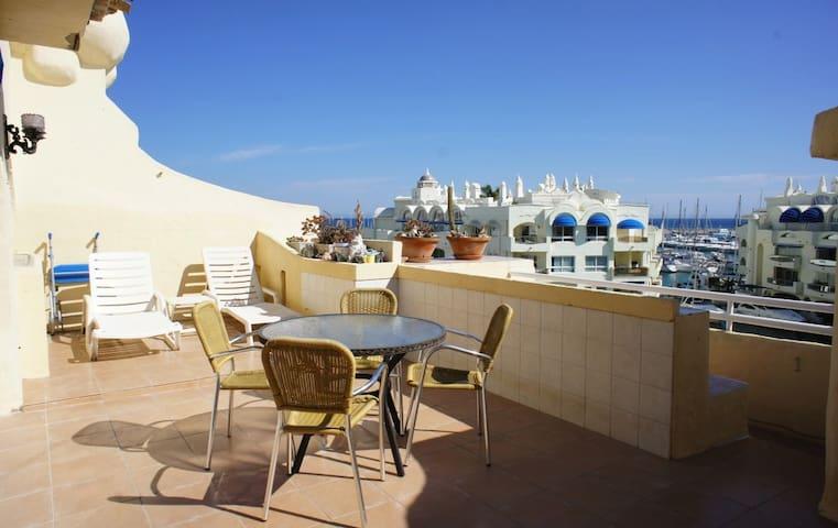 Marina facing apartment with large, sunny terrace