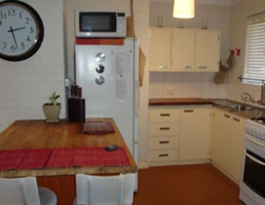 Compact but workable with microwave, full stove and refrigerator.