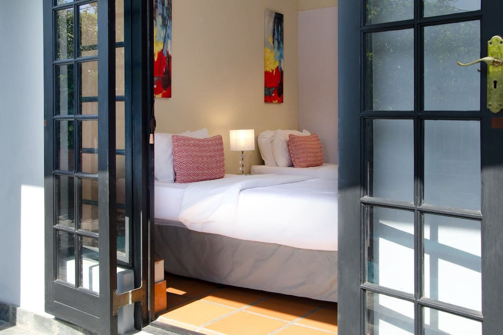 Entry from pool to bottom bedroom with 2 single beds.