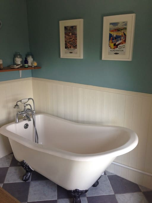 Ensuite bathroom with bath, WC and sink. Access to shower in separate bathroom on ground floor.