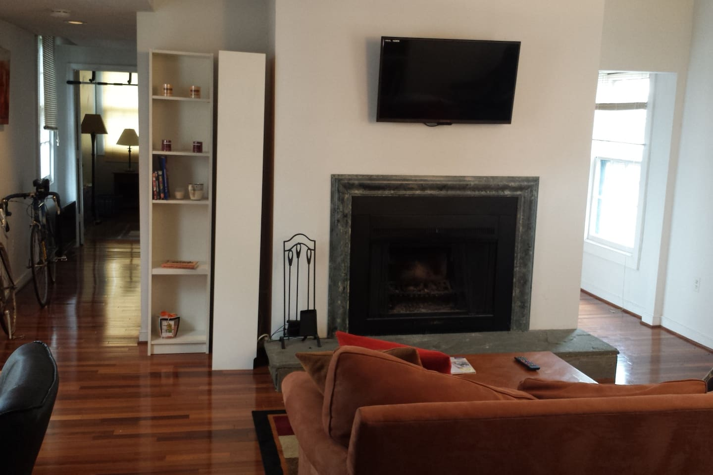 Spacious living room with fireplace and mounted TV (with chromecast set up for easy viewing)