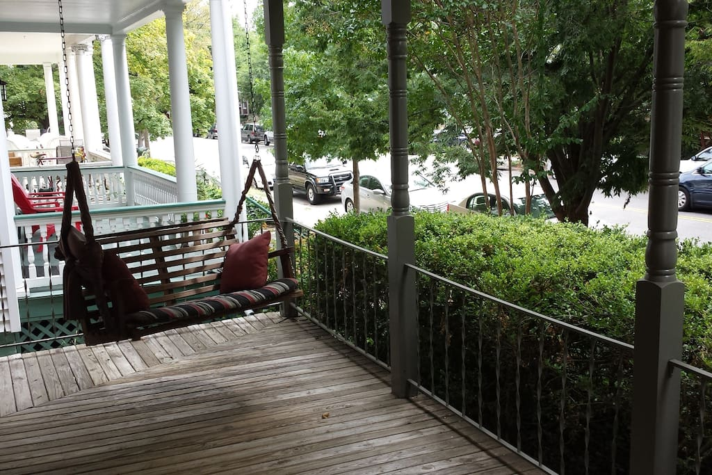 The front of the house has a nice deck with a comfortable porch swing.