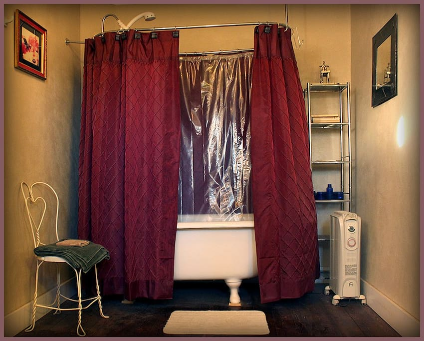 The Beautifully Remodeled bathroom was once used as the entrance into the old hotel (they used outhouses back then!)...and has the original clawfoot tub.