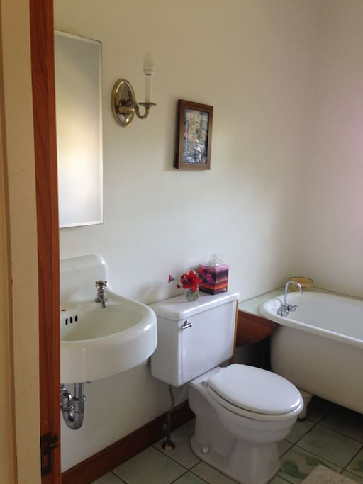 private bathroom with claw foot tub