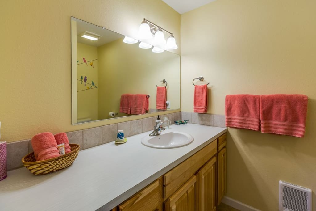 Plenty of counter space and drawers in private bathroom