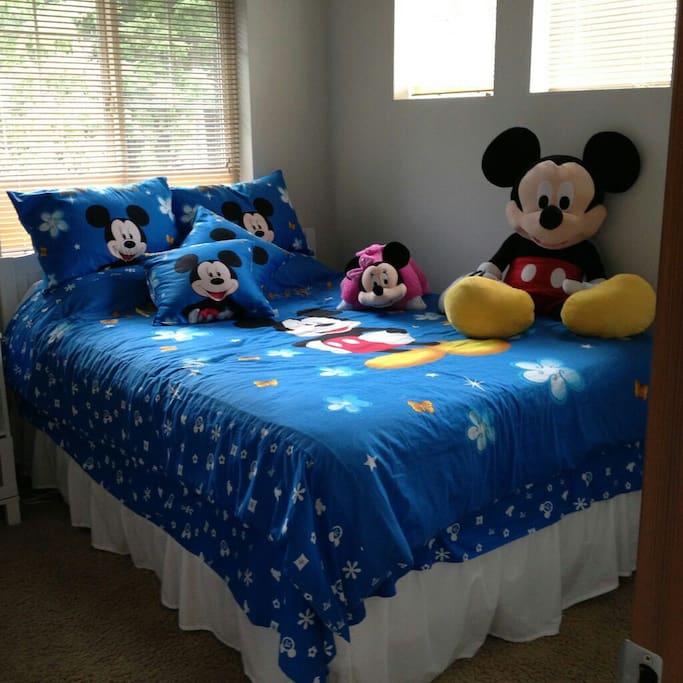 Quiet corner bedroom, Disney-themed.