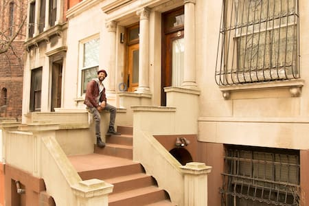 Your Economy -Dorm Style room is located on the top floor of a classic Harlem brownstone, with a full guests-shared kitchen, bath, living area and balcony.  The home is located on Sugar Hill and is across the street from St. Nicholas Park.