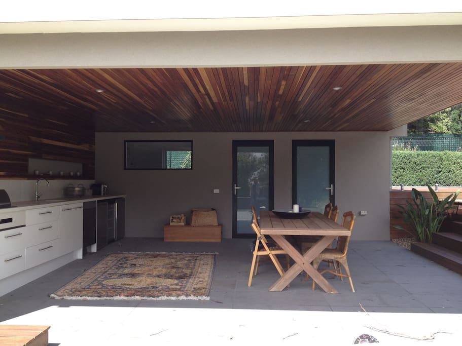 Covered entertainment area and outdoor kitchen.