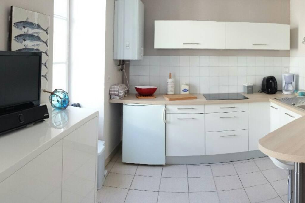 Une cuisine toute équipée et fonctionnelle