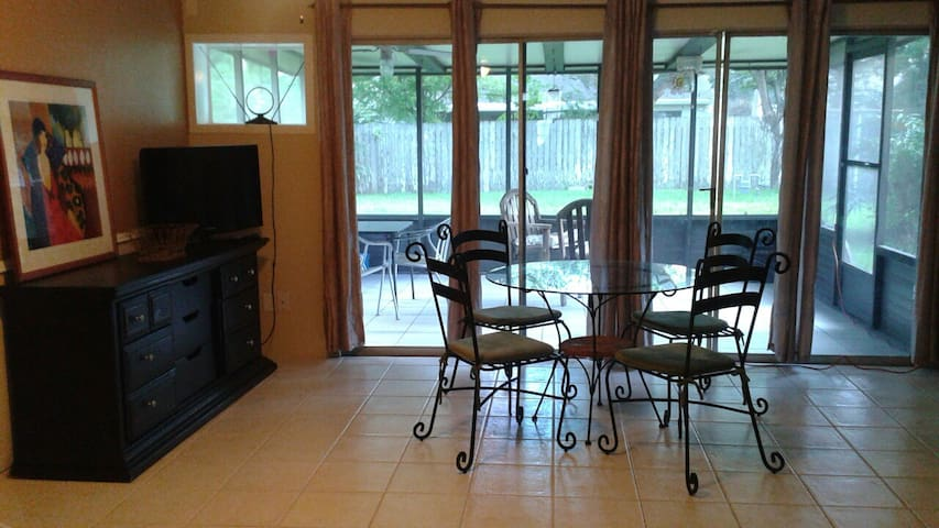 Breakfast and screened porch areas with lg yard, zero gravity chair, hammock, clothesline, vertical garden.
