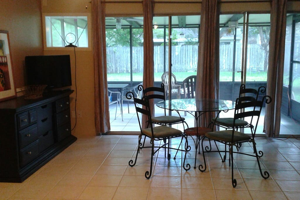Breakfast and screened porch areas with lg yard, zero gravity chair, clothesline, vertical garden.