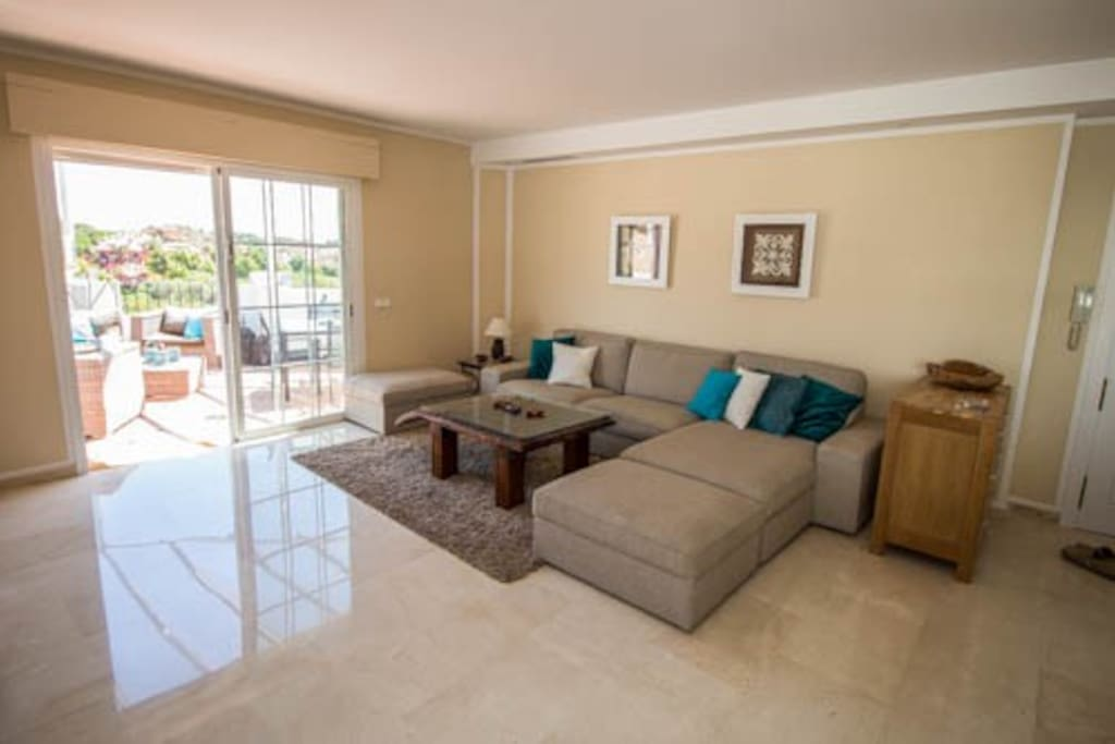 Ample living room with nice furniture and terrace with great views