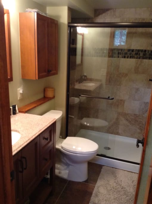 Brand new bath , 4' shower with seat , comfort height toilet