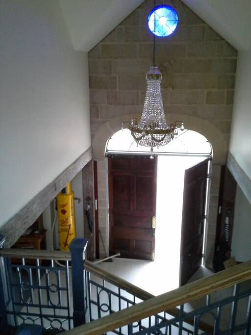 view of entrance from staircase landing