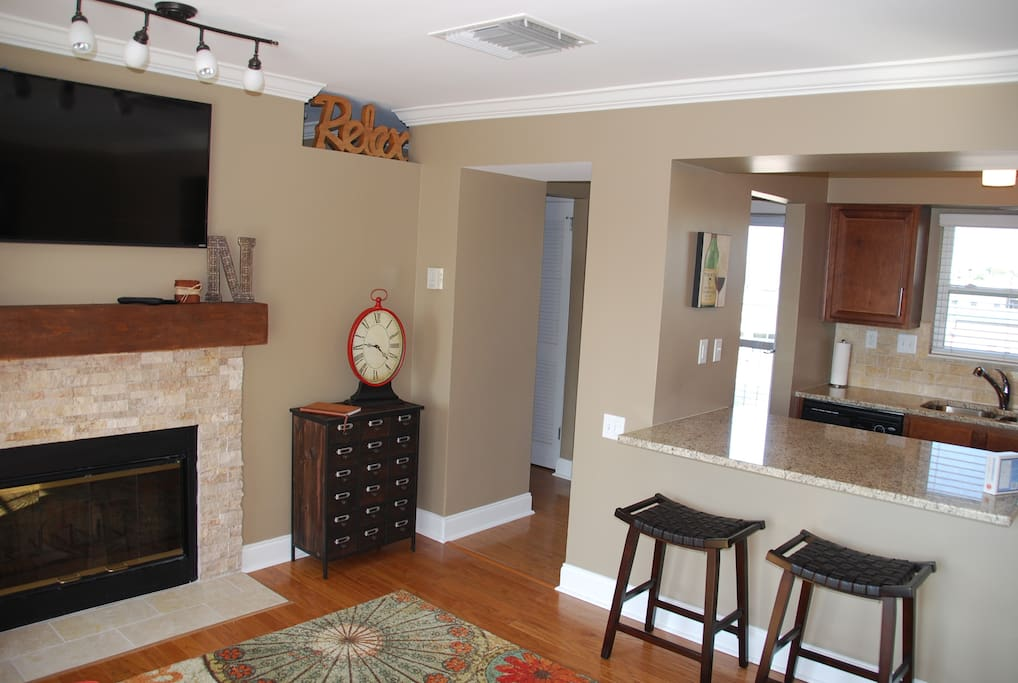 Beautiful bright living room with breakfast bar and updated kitchen