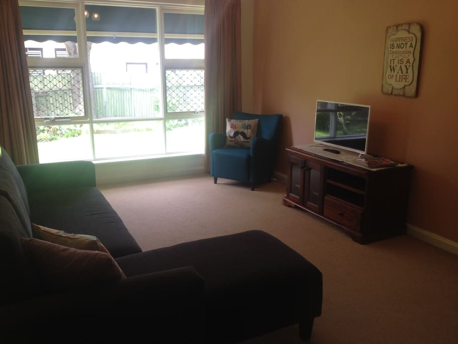 Beautiful Homely Lounge Area with 4 Seater Lounge and Chaise. New TV with USB Port and DVD Player, DVD's, Magazines and Games on request :)