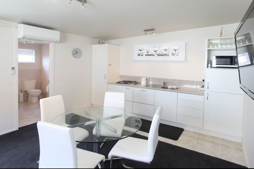 Fully equipped kitchen with microwave,gas hob and fridge