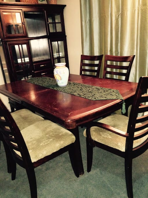 Solid wood dining area for full meals, reading maps, laptop, games or reading next to the window.