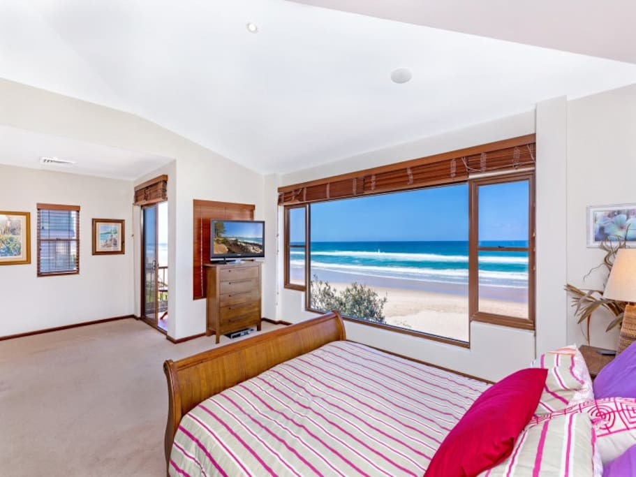 Top floor master bedroom where you can lay in bed and see the sand and waves