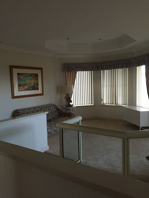 Open sitting area with access to balcony.