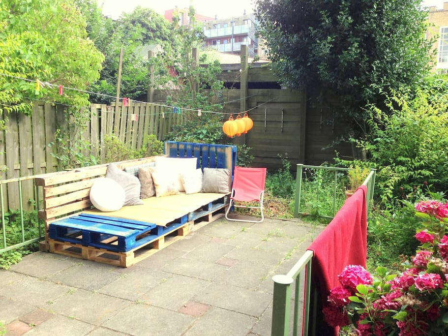 The garden with a chill corner on the blue pallets