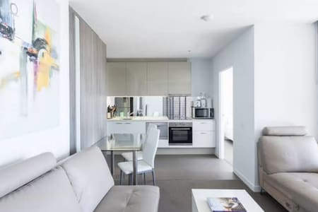 Furnished two bedder in Upper West Side Hudson apartments (220 Spencer St), featuring two queen size beds in two private rooms and the third in a partitioned room connected to the living room/kitchen area.  Two balconies, north/west facing =)