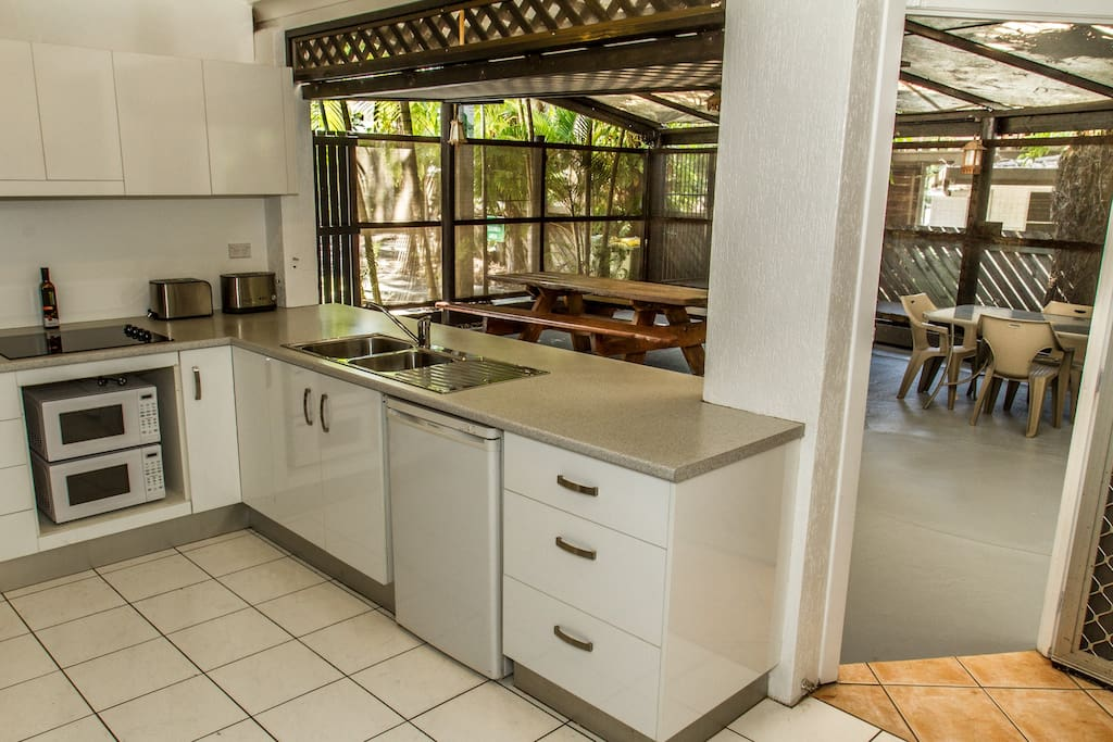 shared kitchen opening to outdoor area