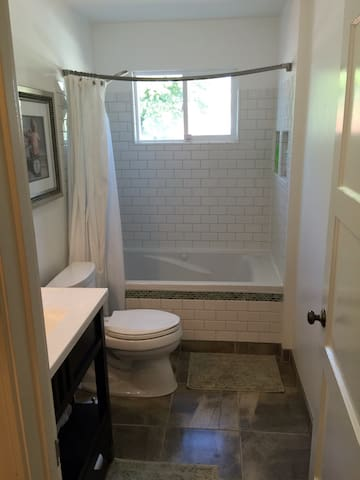 Private bathroom with whirlpool tub and shower