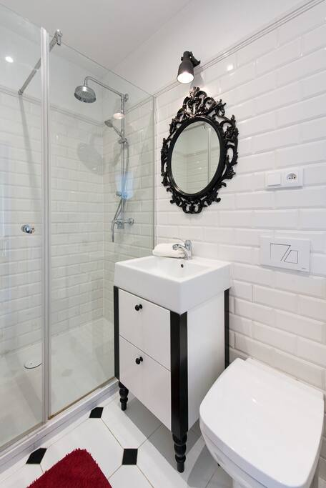 The bathroom with a big shower.