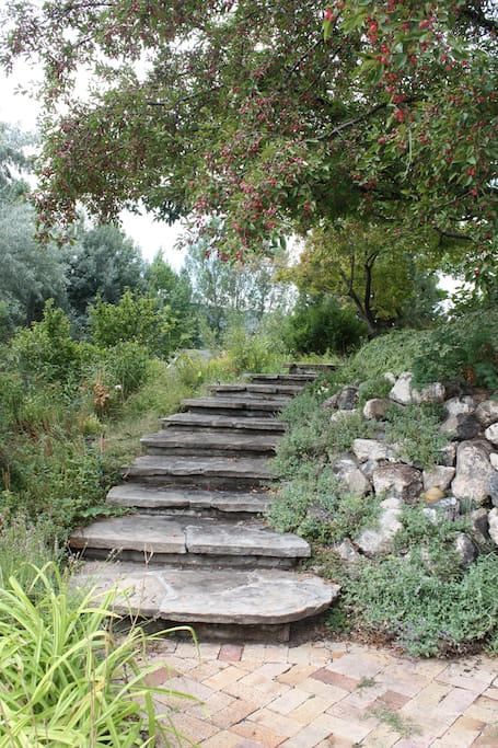 You walk up a stone path to get to the flat.