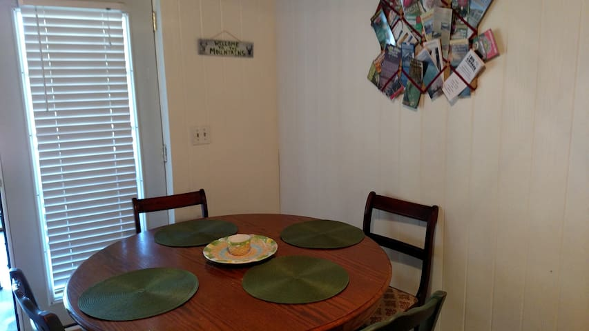 Breakfast table off of kitchen.