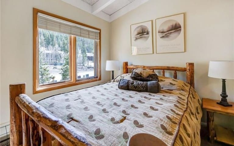 Master bedroom with queen bed and en suite full bathroom