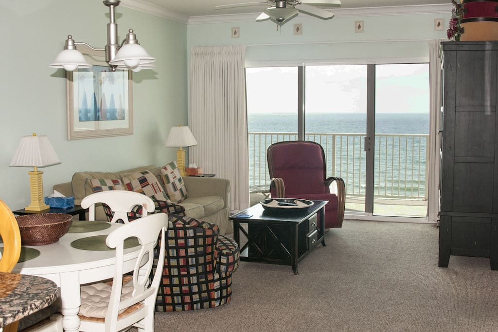 Large living room with views from every space in it. Read a book while staring at the Gulf and in comfort. Rocker recliner, swivel chair. Sofa sleeper.